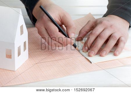 person draws a plan of the site for home / personal residential construction