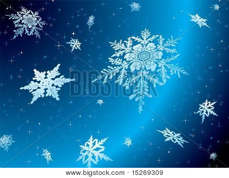 Snowflake falling against a starry nights sky ideal christmas theme