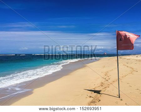White beach in the daytime with perfect blue sea and clear blue sky. Idyllic seaside landscape for holiday relax honeymoon wanderlust travel. Soft sand and clear water. Tropical island paradise