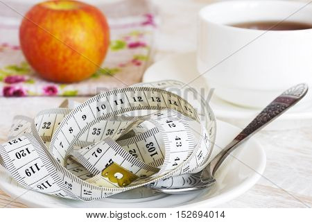 Diet and fitness. Healthy lifestyle concept. Tape measure