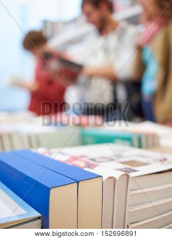 Books and people in the store, abstract composition with beautiful blur