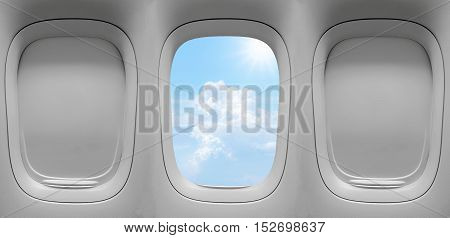 Closeup group of the airplane windows with the clouds sky background.