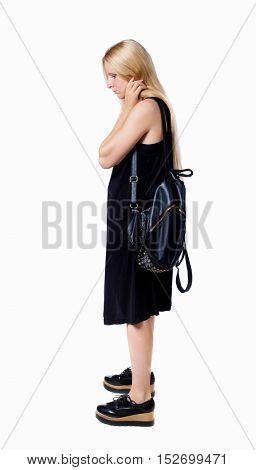 Side view of the distressed girl with a backpack.  girl  watching. Rear view people collection. Isolated over white background. The girl with a leather backpack looks down in frustration.