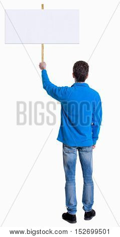 Back view man showing sign board. man holds information plate. Rear view people collection. backside view of person. Isolated over white background. The guy in the blue sweater holding a poster.