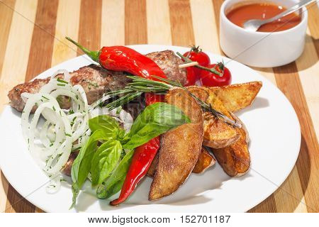 kebab with baked potatoes cherry tomatoes Red pepper basil and rosemary