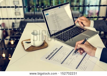 Business Man Filling Out Application Form Concept