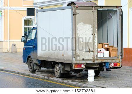 Truck stands on an unloading near warehouse gate