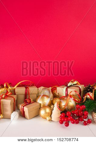 Christmas or New Year background: fur-tree, branches, gifts, colored glass balls, decoration and cones on a white, red  background