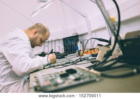 Technician man repairing cmts networking cards technology