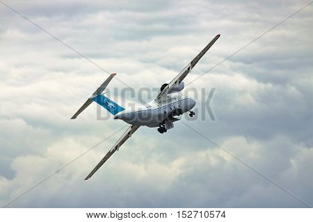 Kiev Region Ukraine - October 3 2010: Antonov An-74 cargo plane is taking off and on the banking turn