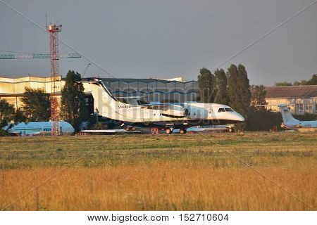 Borispol Ukraine - June 9 2011: Dornier Do-328-300 (Do-328JET) regional passenger jet plane is landing on the runway on sunset