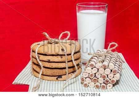 Round Biscuits And Sweet Rolls With A Glass Of Milk