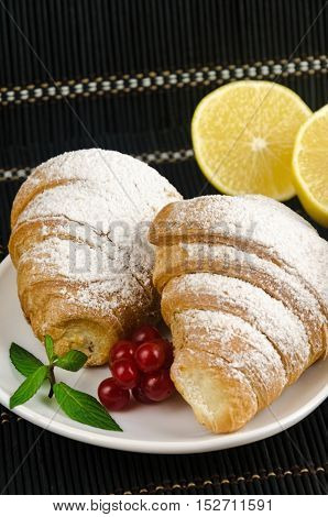 Fresh Crispy Croissants With Sprinkles On Plate Mint