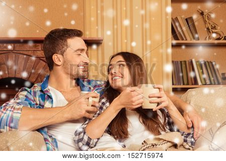 Happy Couple In Love With Plaid And Cups Of Coffee Celebrating Christmas