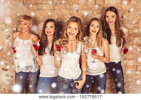 Cheers! Group Of Happy Woman Celebrating Xmas With Shampagne
