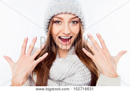 Cheerful Woman  In Warm Hat And Scarf Gesturing With Hands