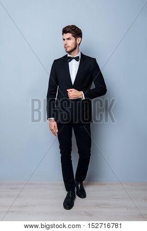 Portrait Of Confident Intelligent Young Businessman In Black Suit