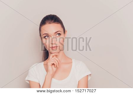 Pretty Minded Young Woman Dreaming On Gray Background