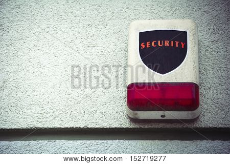 Weathered security alarm with room for text