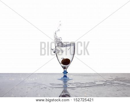 water drop to glass on white background in studio