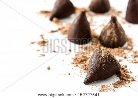 Homemade chocolate truffles isolated on white background