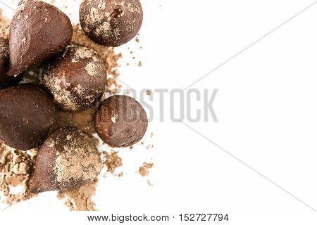 Homemade chocolate truffles isolated on white background