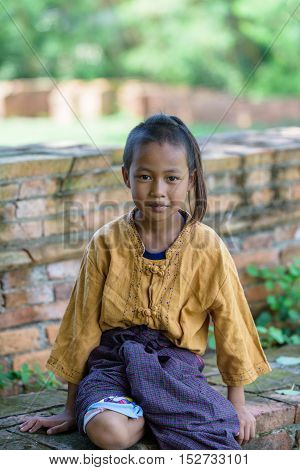 Asian Thai boy with look and smile he dress thai local dress.