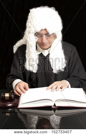 Portrait Of Male Lawyer With Judge Gavel And Book on black background