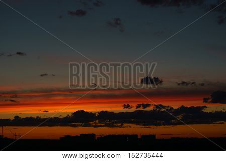 dramatic city sunset with cloud sky background