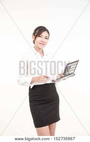 young attractive asian woman beauty image with brush and cosmetic tray in hand on white background.