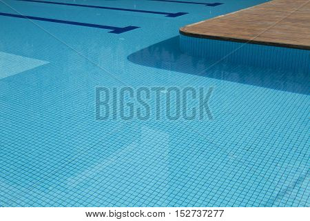 Swimming pool with  blue water and wooden floor