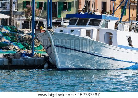 White fishing boat or trawler in the harbor of Port Andratx Spain.