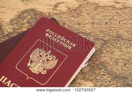Russian Passports on map close up .