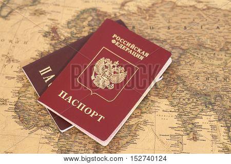 Russian International passports on map close up