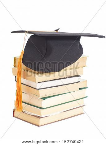 Graduation Hat with books isolated on white background