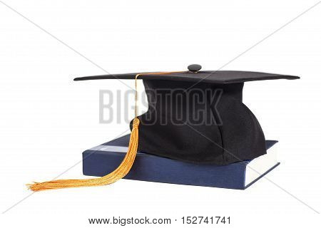 Graduation Cap On Book isolated on a white