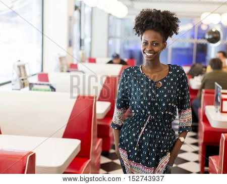 Pretty young black woman in the diner