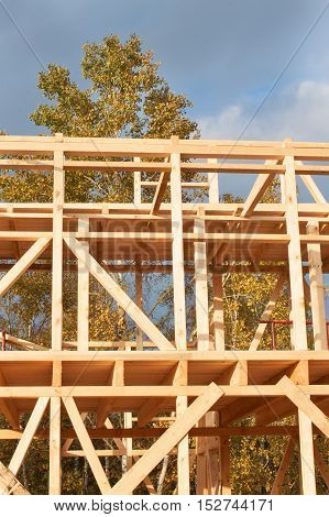 Sunny evening at the construction site of a wooden house. Unfinished house.