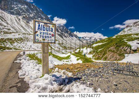 ALBULA PASS, SWITZERLAND - JULY 2016: People hiking on the top of Albula pass near Sankt Moritz Switzerland Europe.