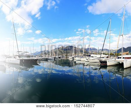 White Yachts In A Blue Sea Water