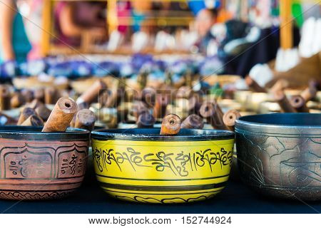 Tibetan singing bowls of various sizes in a market