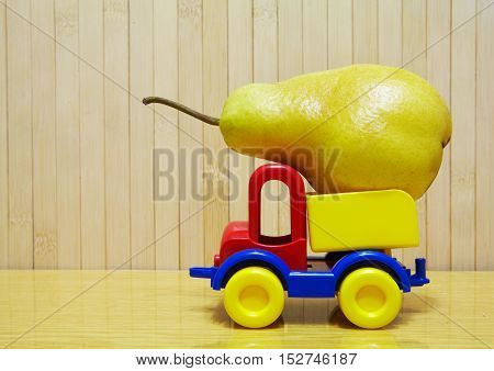 Toy Plastic Car With Pear