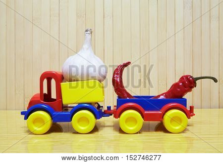 Toy Plastic Car With Garlic And Pepper