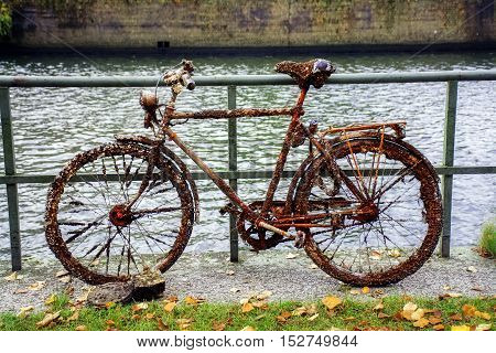 Old discarded bike full of rust small clams and barnacles found in the water of the canal