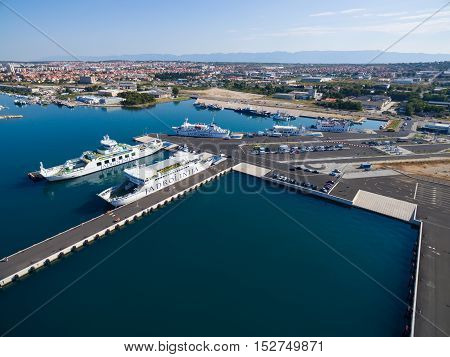 Zadar, Croatia - July 20, 2016: Aerial view of Jadrolinija ferry boats in Gazenica port in Zadar, Croatia. Car ferry boats linking the islands to mainland