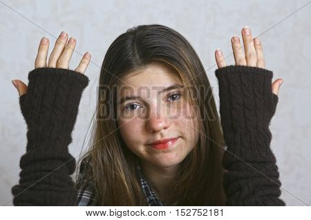 teen girl in knitted brown glows close up portrait. Teenage girl with long hair.
