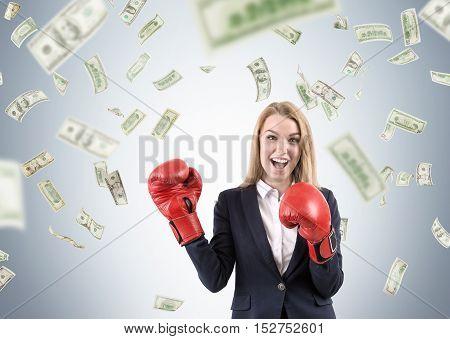 Girl In Boxing Gloves Under Dollar Rain