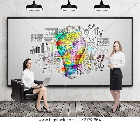 Girl with laptop sitting near whiteboard with giant light bulb sketch surrounded by graphs. Her colleague is standing nearby. Concept of business idea. 3d rendering
