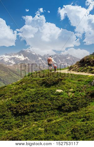 Father With His Sonhiking In Swiss Alps, Madrisa Mountain, Davos, Switzerland