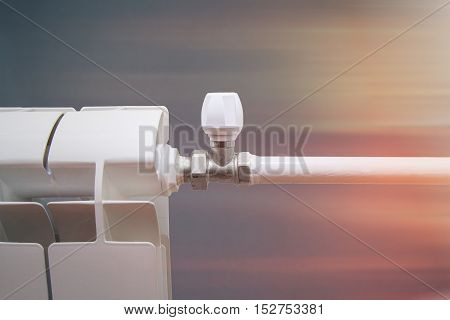 radiator with a valve for regulating the heat